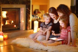 family enjoying fireplace