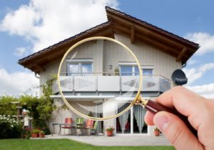 39653963 – person hand with magnifying glass over luxury house