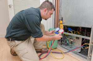 AC Conditioning Technician Checking Freon Levels