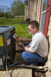 air conditioning technician filling freon cooling agent